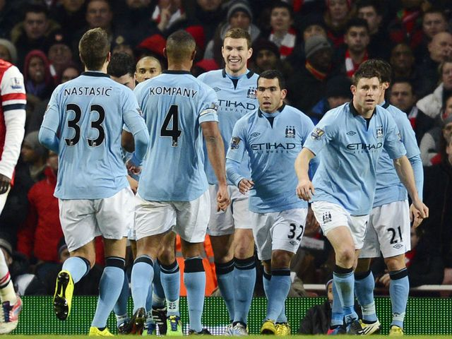 Dzeko celebrates his goal for Man City