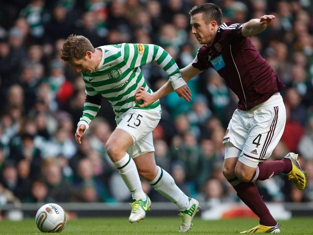 Kris Commons gets away from Danny Wilson