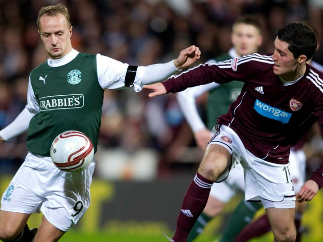 Leigh Griffiths and Dylan McGowan vie for the ball