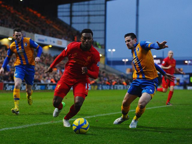 Daniel Sturridge tries to get past Chris Clements