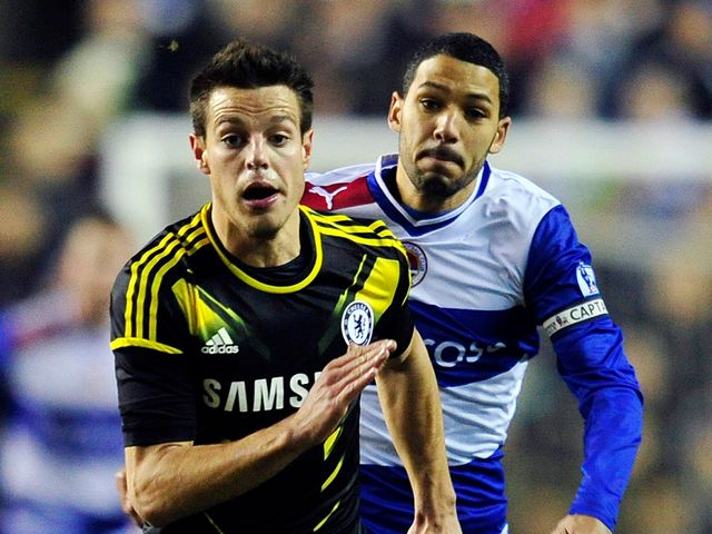 Cesar Azpilicueta tries to get clear of Jobi McAnuff