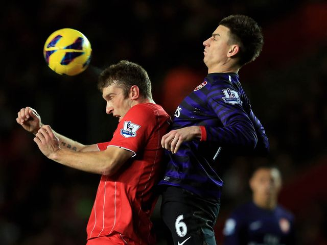 Rickie Lambert competes with Laurent Koscielny