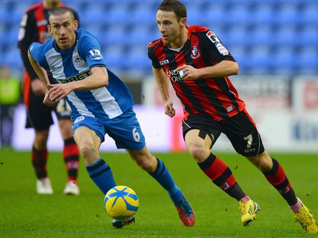 David Jones chases Bournemouth's Marc Pugh