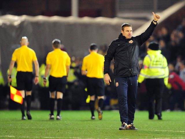 David Flitcroft celebrates at the full-time whistle
