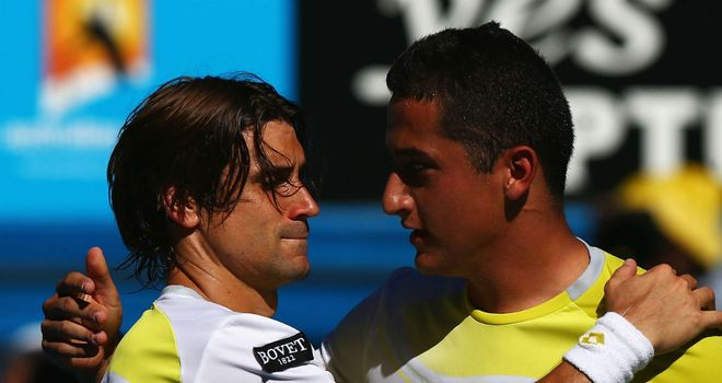 David Ferrer (L) and Nicolas Almagro (R) embrace after five-set thriller
