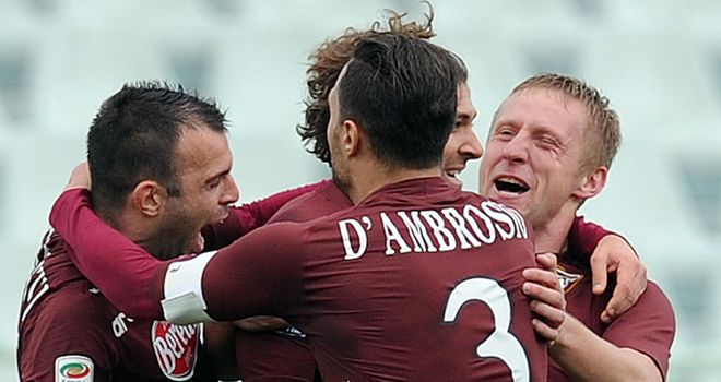 Alessio Cerci is mobbed after scoring