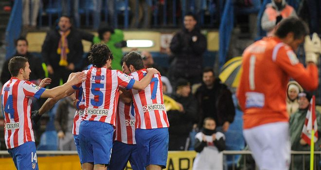 Atletico Madrid celebrate Koke's goal.
