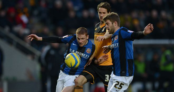 Action from the fourth round all-Championship clash