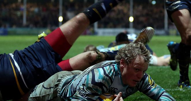 Scott Hamilton dives over under the challenge of Andy Goode