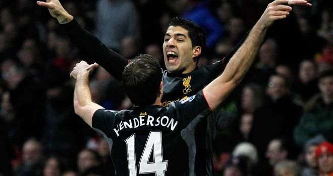 Jordan Henderson celebrates with Luis Suarez