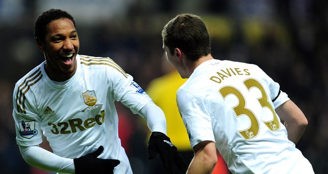 Jonathan De Guzman's fired a second-half brace to help Swansea past Stoke