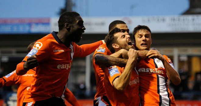 Alex Lawless (c): Celebrates his goal for Luton
