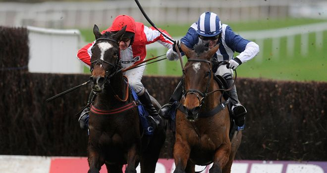 Monbeg Dude (left) outbattles Teaforthree to win the Welsh National