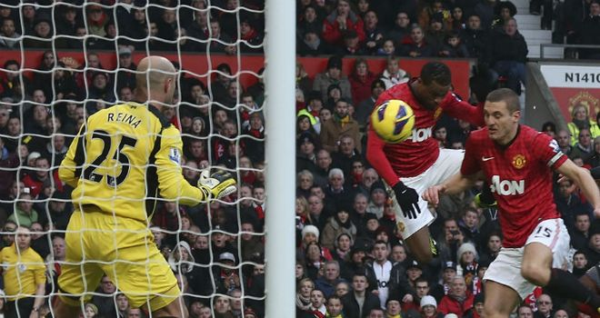 United go 2-0 up when Evra's header deflects in off captain Nemanja Vidic