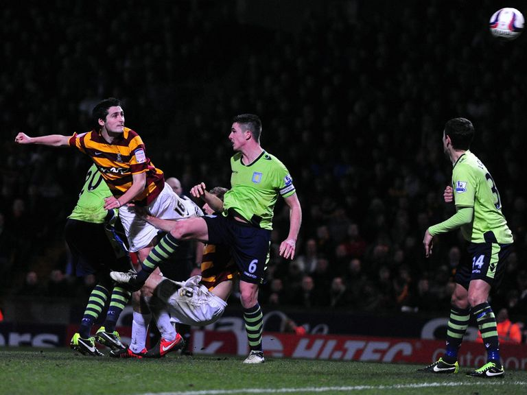 Carl McHugh heads home Bradford's third goal
