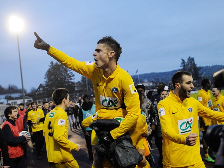 Epinal celebrate their cup win over Lyon