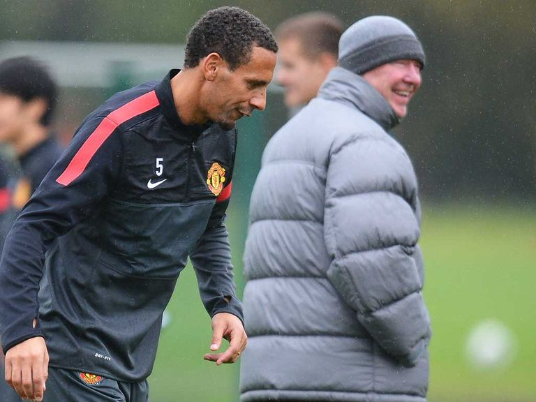 Ferdinand (left) and Ferguson: Boss 'not panicking'