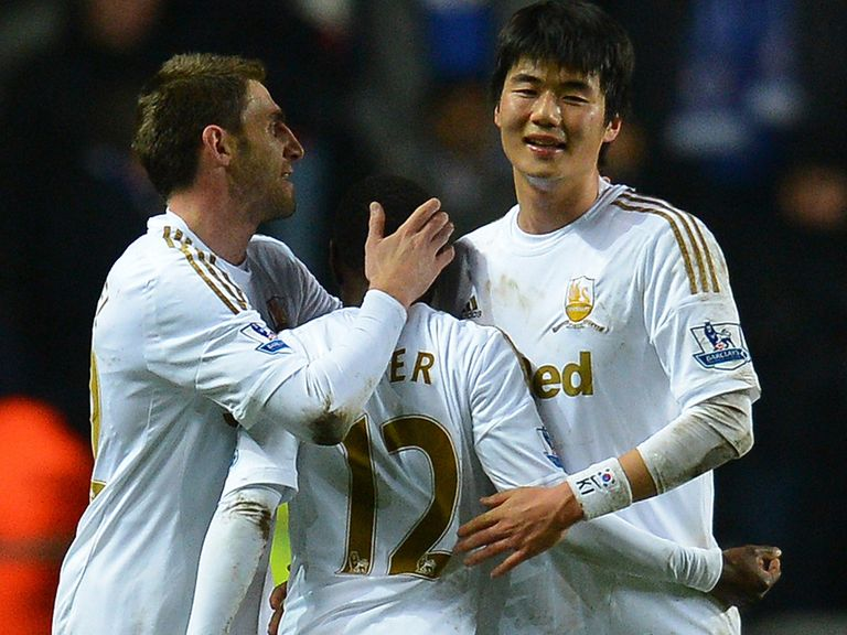 Swansea celebrate reaching the Capital One Cup final