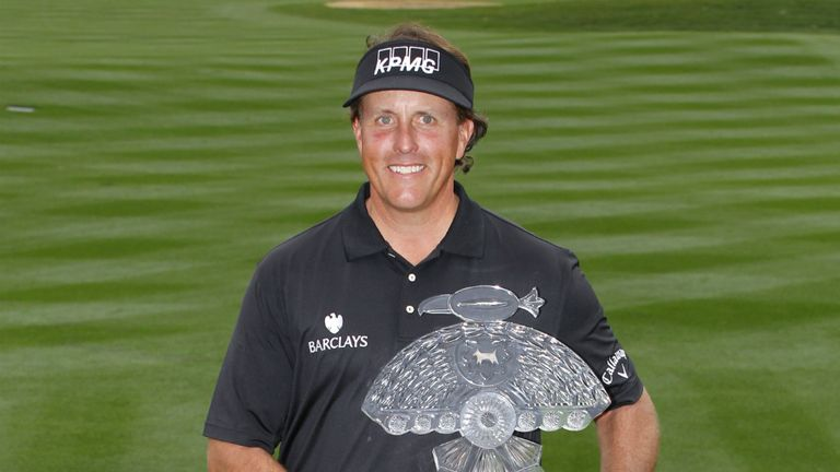 Phil Mickelson: Champion displays the Phoenix Open trophy last year