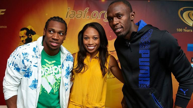 Usain Bolt and Yohan Blake pose with American sprinter Allyson Felix