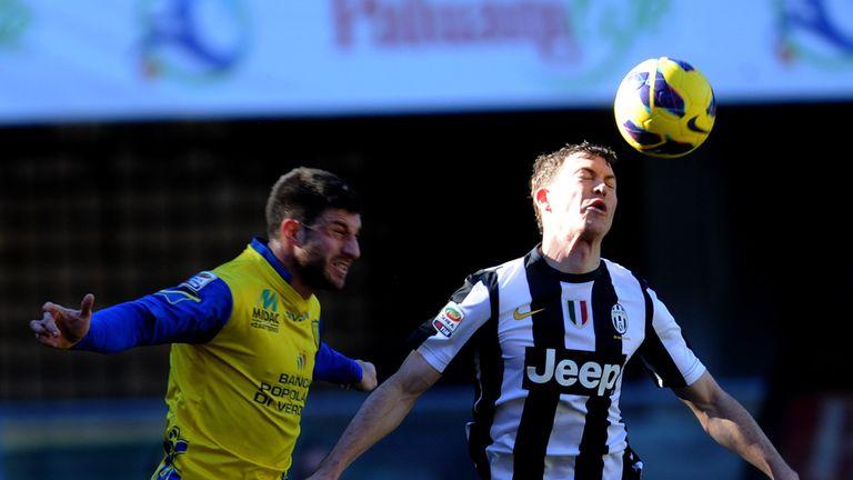 Stephan Lichsteiner battles with Bojan Jokic