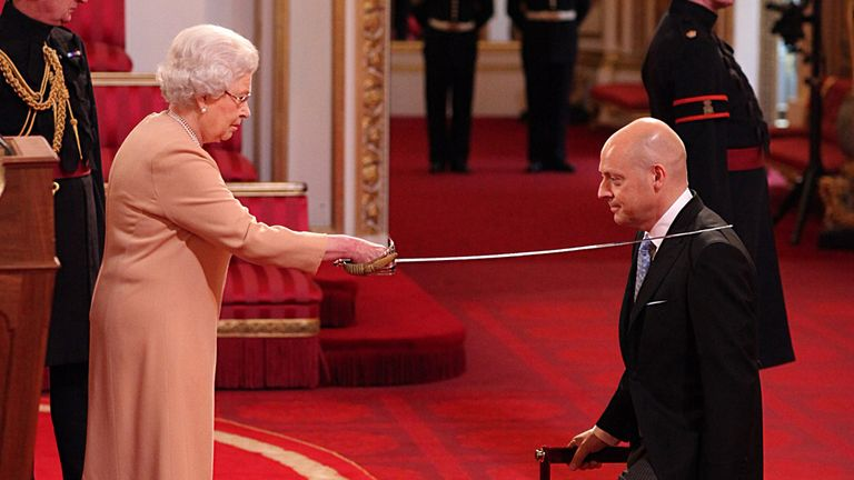 Sir Dave is bestowed the honour by Queen Elizabeth