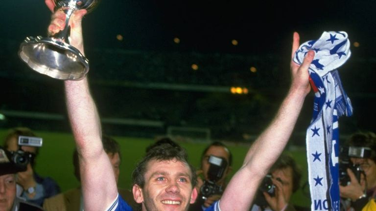 Toffees glory: Reid lifts the European Cup Winners' Cup with Everton in 1985