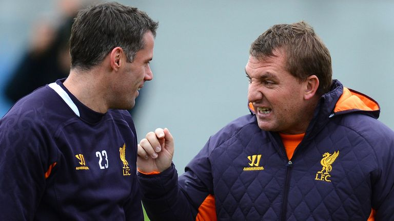 Jamie Carragher (left) still has plenty to offer Liverpool says Brendan Rodgers (right)