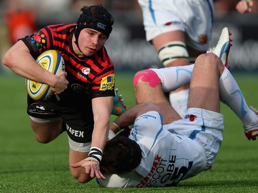 Ben Ransom of Saracens is tackled by Luke Arscott
