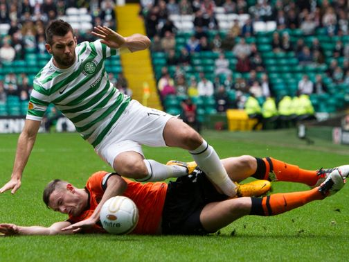 Joe Ledley takes a tumble.