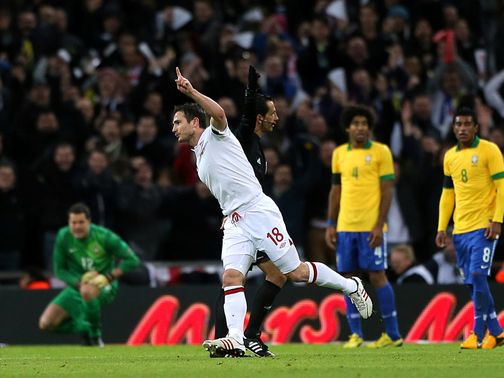 Frank Lampard celebrates his winner against Brazil