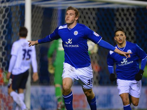 Chris Wood celebrates scoring the first goal for Leicester