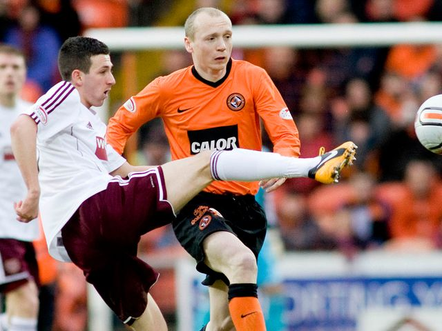 Jason Holt and Willo Flood battle for possession