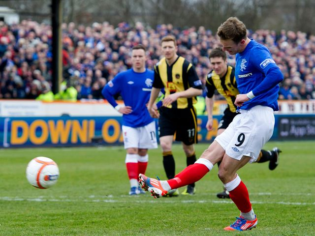Dean Shiels scores Rangers' equaliser from the spot