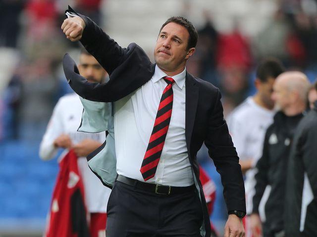 Malky Mackay enjoys Cardiff's victory.