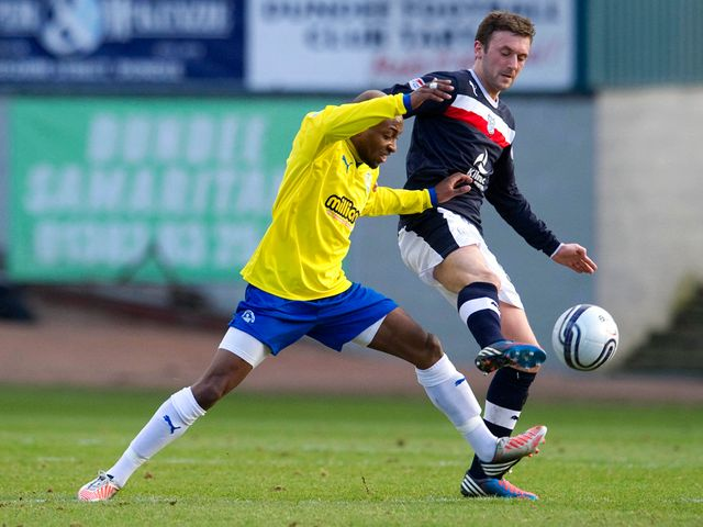 Kevin McBride is closed down by Fouad Bachirou.