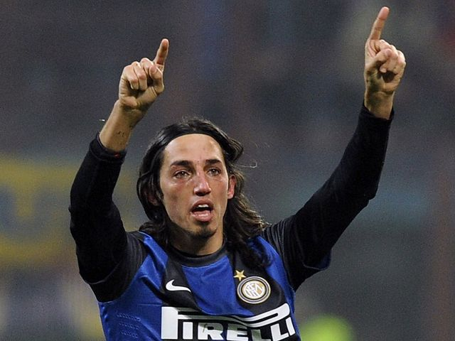 Ezequiel Schelotto celebrates his goal