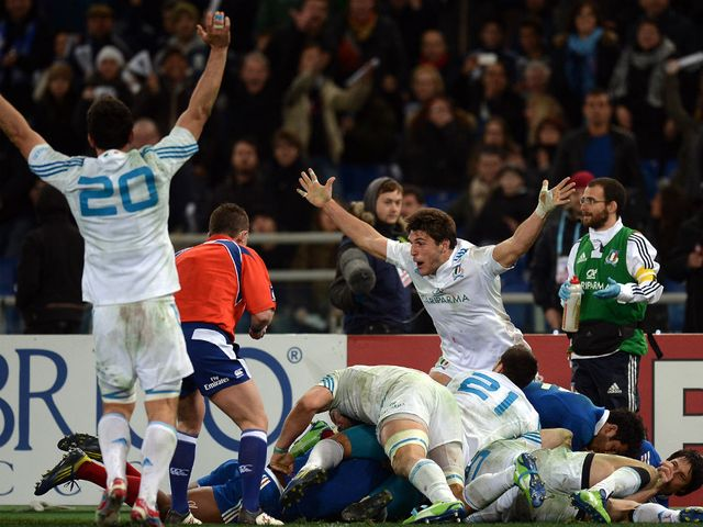 Italy celebrate at the final whistle