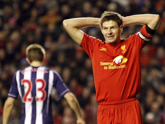 Gerrard is left frustrated after seeing his penalty saved