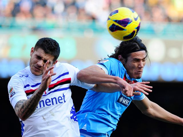 Edinson Cavani wins a header for Napoli