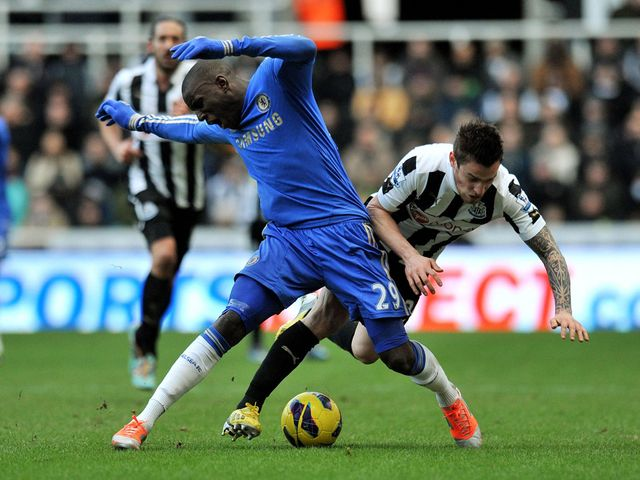 Demba Ba holds off Mathieu Debuchy.
