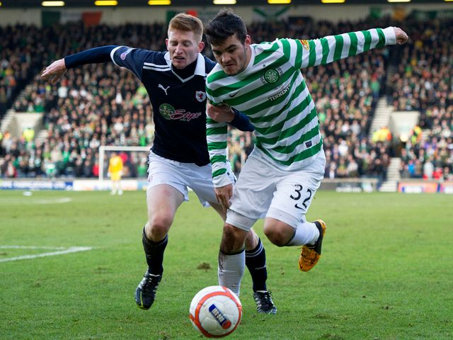 Tony Watt tries to get the better of Jason Thomson.