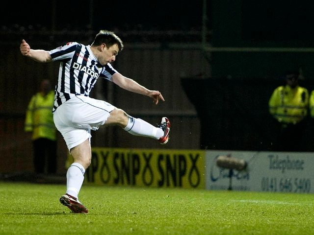 Paul McGowan scores from the penalty spot