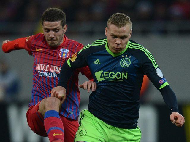 Ajax's Kolbeinn Sigthorsson holds off Florin Gardos