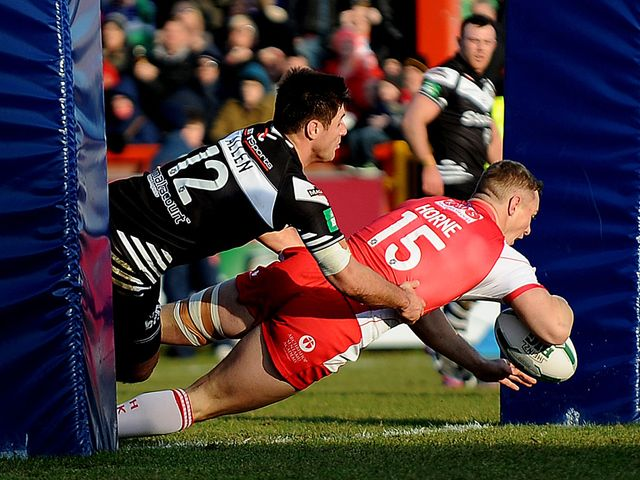 Graeme Horne goes in for a Rovers try