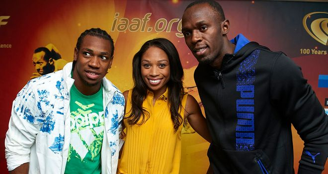 Usain Bolt and Yohan Blake pose with American sprinter Allyson Felix