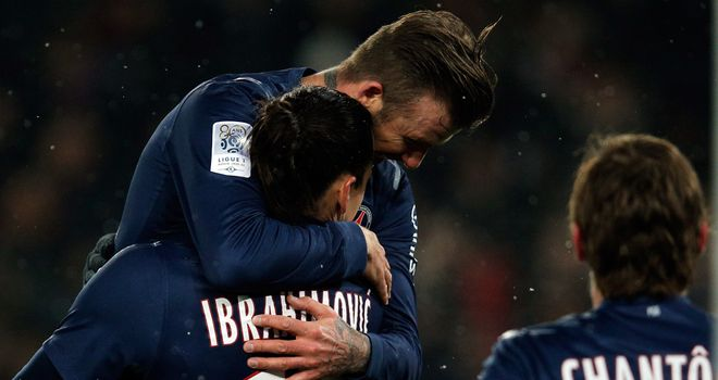 Beckham and Zlatan Ibrahimovic celebrate PSG's second.