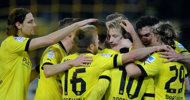 Marco Reus is mobbed after finding the net