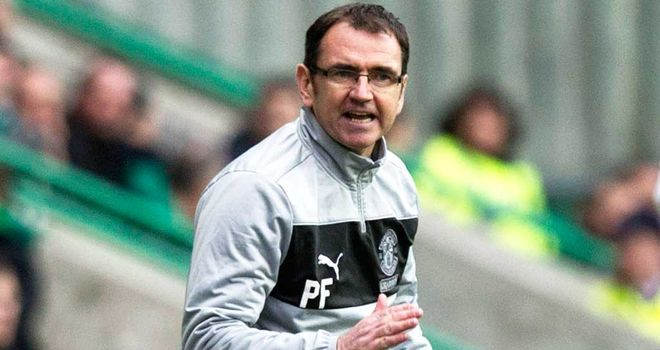 Pat Fenlon celebrates the penalty save from Ben Williams