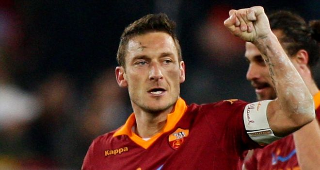 Francesco Totti celebrates his winning goal for Roma